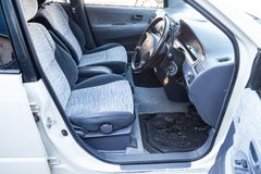 View to the inerior of Toyota Ipsum 1998 with front seats, steering wheel and dashboard after cleaning before sale. Novosibirsk, Russia - 04.10.2019: View to the royalty free stock image