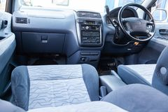 View to the inerior of Toyota Ipsum 1998 with front seats, steering wheel and dashboard after cleaning before sale. Novosibirsk, Russia - 04.10.2019: View to the royalty free stock images