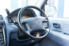 View to the inerior of Toyota Ipsum 1998 with front seats, steering wheel and dashboard after cleaning before sale. Novosibirsk, Russia - 04.10.2019: View to the stock photos