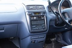 View to the inerior of Toyota Ipsum 1998 with front seats, steering wheel and dashboard after cleaning before sale. Novosibirsk, Russia - 04.10.2019: View to the stock photo