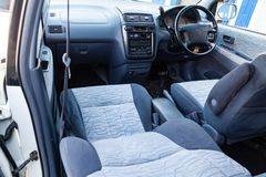 View to the inerior of Toyota Ipsum 1998 with front seats, steering wheel and dashboard after cleaning before sale. Novosibirsk, Russia - 04.10.2019: View to the stock photography