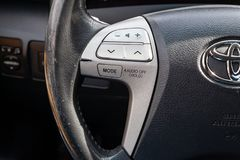View to the interior of car with steering wheel with audio control buttons after cleaning before sale on parking. Novosibirsk, Russia - 07.09.2019: View to the stock image
