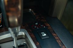 View to the interior of Toyota Land Cruiser 200 with dashboard, seat heater button and shiftgear after cleaning before sale on. Novosibirsk, Russia - 03.10.2019 royalty free stock images