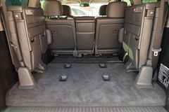 View to the interior of Toyota Land Cruiser 200 with luggage compartment with folded third row of seats after cleaning before sale stock photos