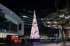 View to internal square of Porta Nuova business centre and illuminated Christmas tree. Royalty Free Stock Images
