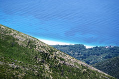 View to Ionian Sea coast from top of Llogora mountain. Crystal clean water and a shore with white sand on Ionian Sea shore captured from top of Llogora mountain Royalty Free Stock Photography