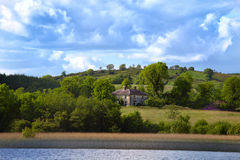 View to Irish house on River Shannon. View to Irish cottage from boat river Shanon Royalty Free Stock Image
