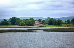 View to Irish house on River Shannon. View to Irish cottage from boat river Shanon Stock Images