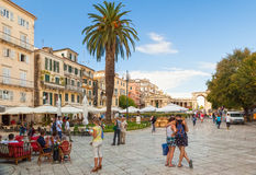 View to the Kapodistriou street with cafe tables and tourists, K Royalty Free Stock Photo