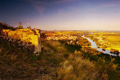 View to Labe river in Litomerice city from hill Radobyl with ruine in foreground in CHKO Ceske Stredohori tourist area at sunset Stock Photo
