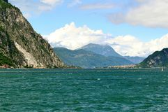 View to lake Como near Lecco in sunny windy summer day. Stock Images