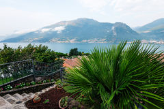 View to the lake Como from villa. European vacation. Alps, Italy royalty free stock image