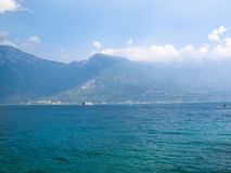 View to Lake Garda with a ferry boat and numerous small boats in the distance Royalty Free Stock Image