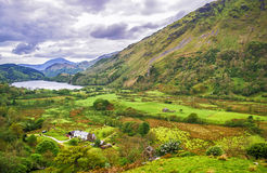 View to lake and houses in Snowdonia National Park stock photography
