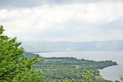 A view to lake Ohrid. From a mountain. A village in the shore of the lake, in Ohrid, Macedonia, on May 18th, 2011 Royalty Free Stock Image