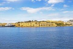 View to the Lazzaretto of Manoel Island, Gzira`s Marsamxett Harbor, Malta from Lazzaretto Creek. Mediterranean Sea view with a yacht to the Lazzaretto of Manoel Stock Photo