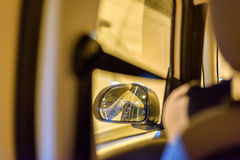View to left car mirror from back seat in tunnel.  Stock Images
