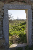 View to the lighthouse. Though an old window Royalty Free Stock Photos