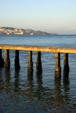 View to Lisbon at sunset from a pier on Tagus river, Portugal Stock Images