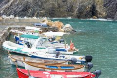 View to a little port and rock coast of Vernazza. View to a little port and rock coast in Vernazza, Cinque Terre, Italy. Parked boats stock photography