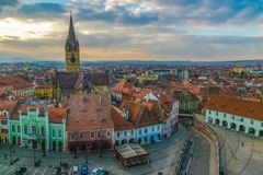 View to the Little Square and the Sibiu Lutheran Cathedral in the Transylvania region, Sibiu, Romania.  stock photography