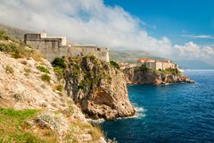 Lovrijenac fortress in Dubrovnik. View to Lovrijenac fortress and Dubrovnik old town. Copy space in sky Royalty Free Stock Photos