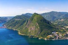 View to Lugano city, Lugano lake and Monte San Salvatore from Mo. Nte Bre, Ticino, Switzerland Royalty Free Stock Photos