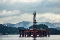 View to the Lyngdalsfjord with drilling rig in Norway.  Stock Image