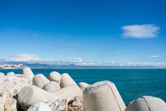 A view to Maditerranean sea and Torremolinos from a pier at Benalmadena port. Andalusia, Spain Royalty Free Stock Image