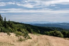 View to Mala Fatra mountain range from Radhost hill in Moravskoslezske Beskydy mountains in Czech republic. During summer day with blue sky and clouds Royalty Free Stock Images