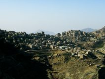 View to Manakha fortress and old city and terrace farming in Yemen. View to Manakha fortress and old city and terrace farming,Yemen Stock Photos