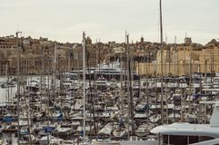 View to marina in Il-Birgu and Valletta, Malta. View to marina in Il-Birgu, Fort St. Angelo and Valletta royalty free stock images