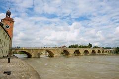 View to the medieval stone bridge across Danube river in Regensburg, Germany. REGENSBURG, GERMANY - SEPTEMBER 03, 2010: View to the medieval stone bridge across Royalty Free Stock Photo