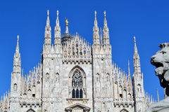 View to Milan Duomo facade and lion's head with blue sky in background. Royalty Free Stock Photography
