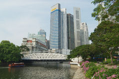 View to the modern buildings and the old Cavenagh bridge in Singapore, Singapore. Royalty Free Stock Photo