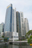 View to the modern buildings and the old Cavenagh bridge in Singapore, Singapore. Stock Photo