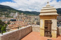 View to the Monaco city buildings with the old watchtower at the foreground. Royalty Free Stock Photos