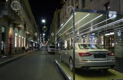 View to Montenapoleone fashion street and Maserati car at New Year 2014 midnight. Stock Image