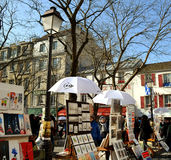 View to Montmartre and paintings. Royalty Free Stock Images