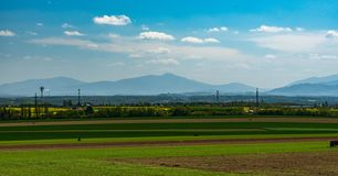 View to Moravskoslezske Beskydy mountain range with highest Lysa hora hill from field above Ostrava-Poruba city in Czech republic royalty free stock images