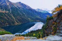 View to Morskie oko, lake in Tatry mountains. October day in polish mountains, valley view after trekking Royalty Free Stock Photography