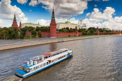 View to Moscow Kremlin from Bolshoi Kamenniy bridge. Over river with ship under clouds, Russia Stock Images