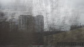 View to Moscow from moving train on dull day, Russia. Traveling by train through Moscow and looking at apartment blocks and industrial facilities passing by stock video