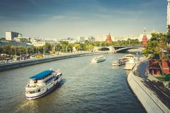 View to Moscow river tourist boats and Kremlin towers, Moscow, Russia stock photos