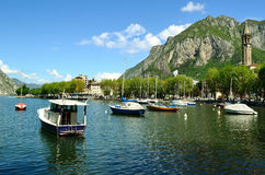 View to motor and sailing boats anchored in the Lecco bay Royalty Free Stock Images