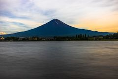 View to Mount Fuji in Summer with blue sky and clouds water lake Stock Photography