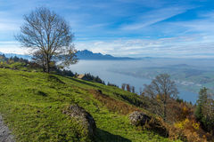 View to Mount Pilatus and Lake Lucerne covered with frog, Alps, Switzerland Stock Photo