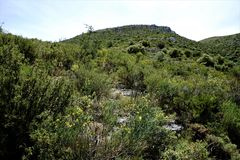 View to a mountain peak in the Sierra del Penon. Spain Stock Images