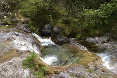 View to mountain pure water stream in a spring sun Royalty Free Stock Photo