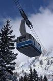 View to the mountains and blue ski tram at Snowbird ski resort in Utah Stock Photos